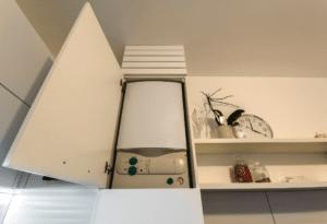 Regulations on Boiler in Kitchen Cupboard